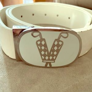 Belt with golf clubs buckle